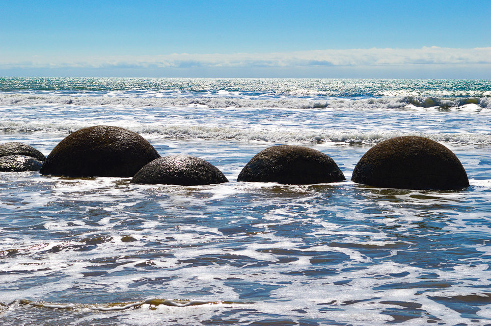 round boulders in the sea