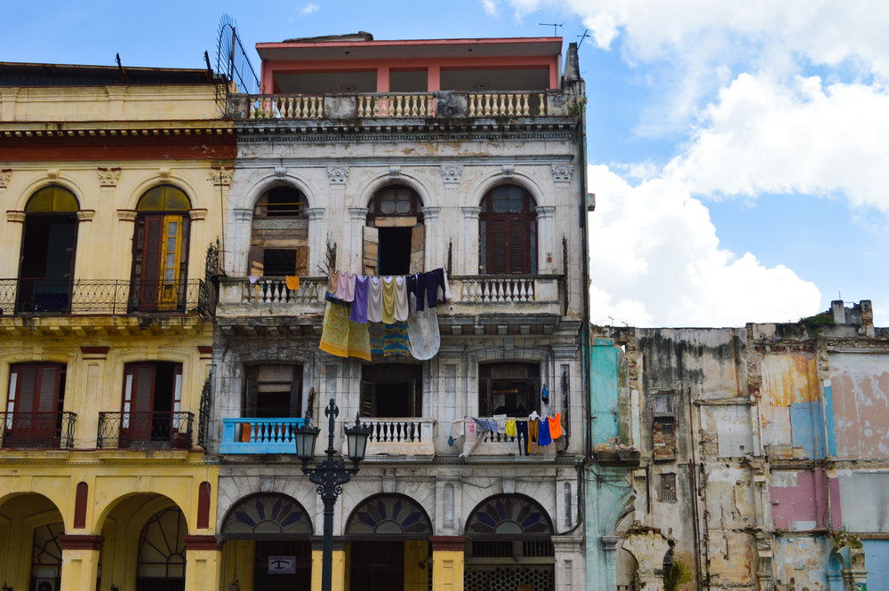 washing hung out on grand crumbling building in havana