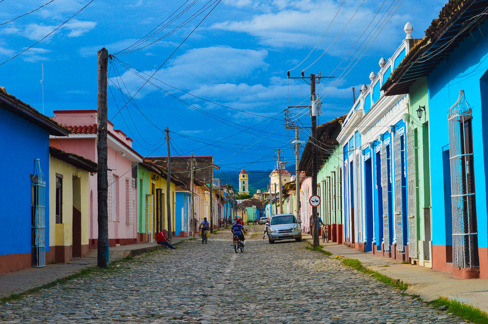 colourful houses and cobbled street in vinales cuba