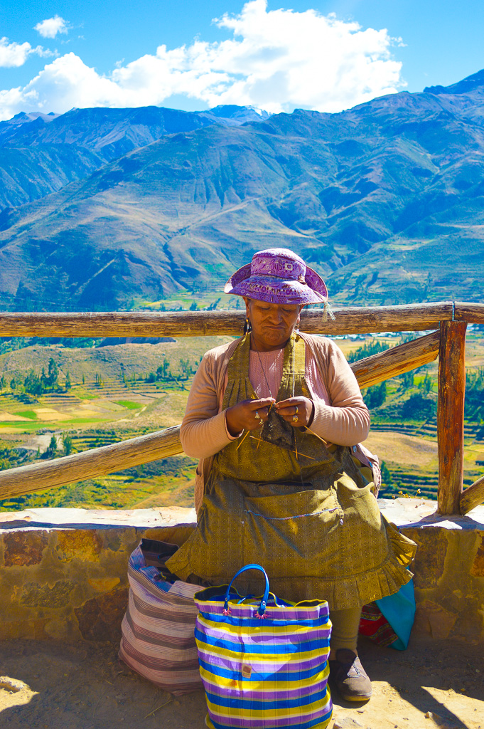 lady knitting with a backdrop of rice terraces