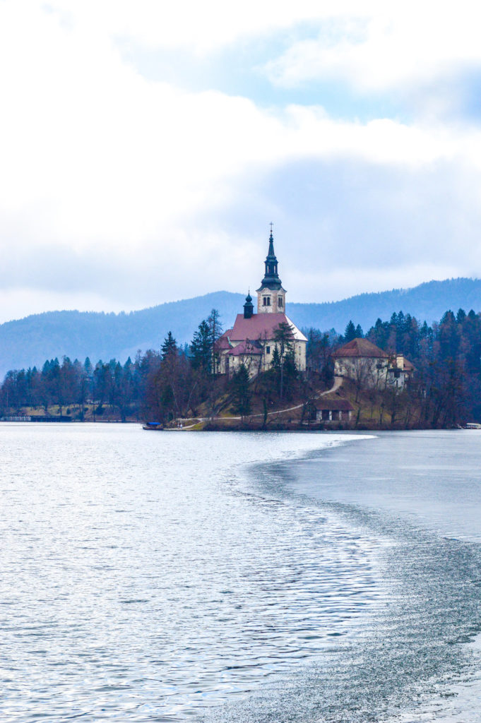 frozen lake bled iin winter with church on island