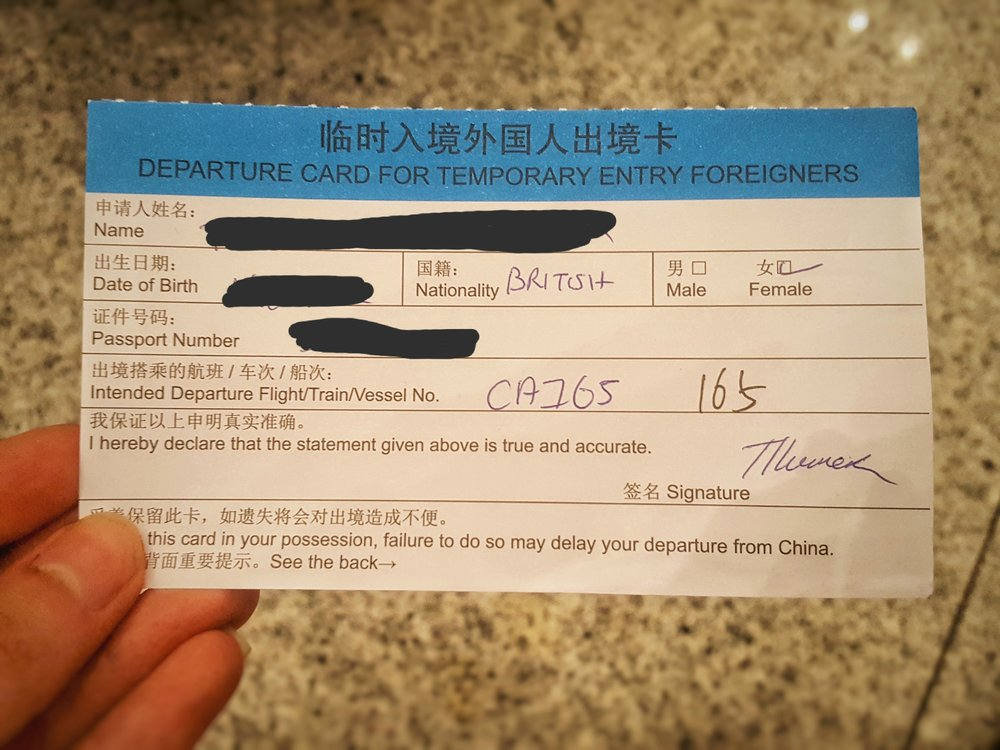 hand holding china visa temporary entry card