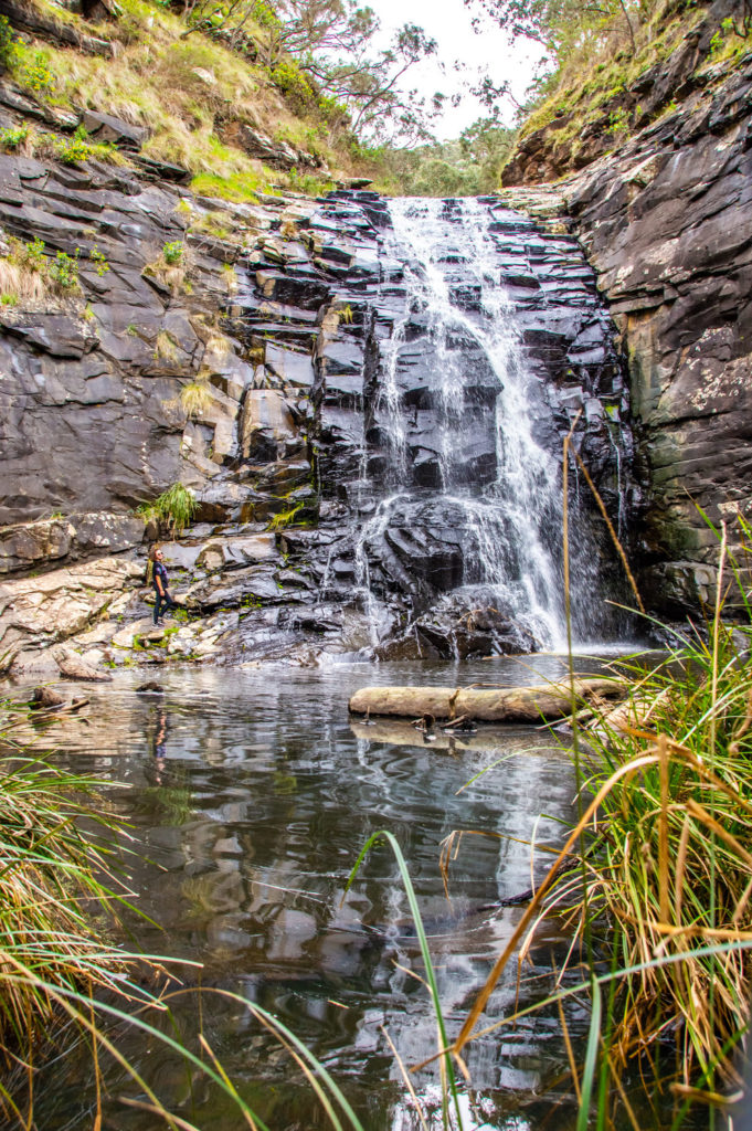 waterfall flowing into lake in australia