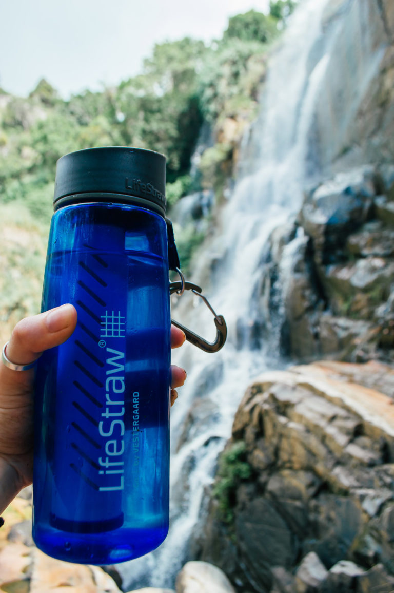 lifestraw go water bottle in front of waterfall