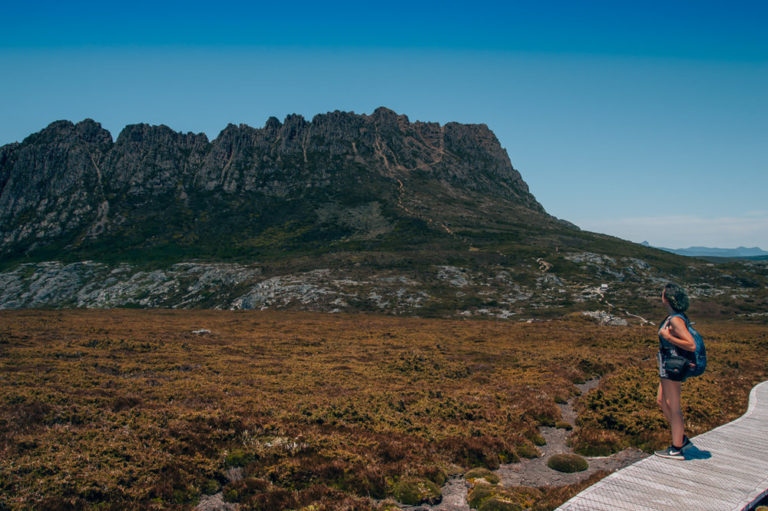 girl hiking cradle mountain in tasmania