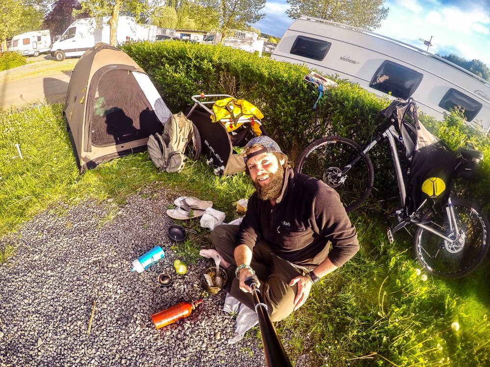 go pro selfie with tent and bike on campsite