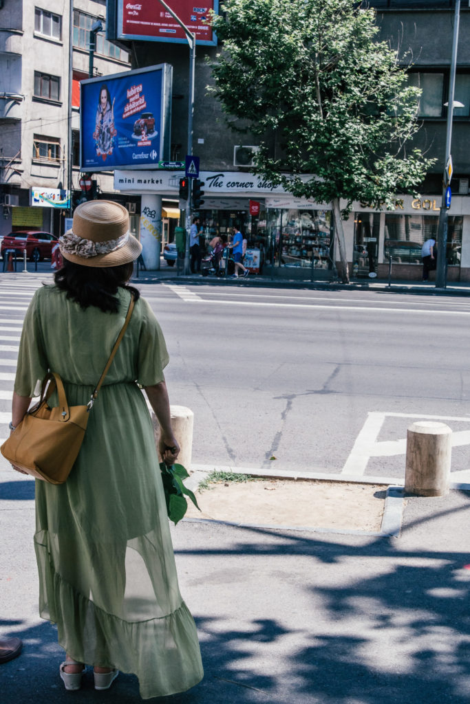 lady in dress crossing the road