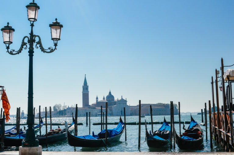 venice with boats and blue sky