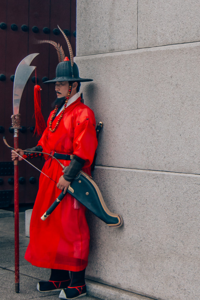 guard wearing traditional clothing at ceremony in Seoul