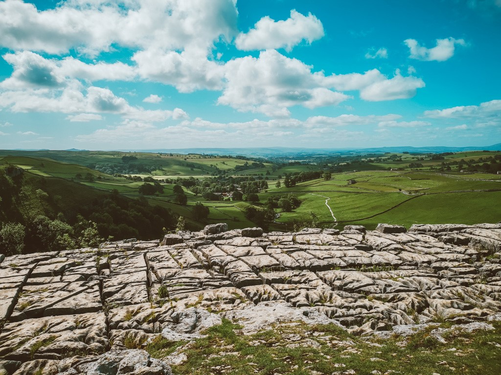 malham cove in Yorkshire with blue sky