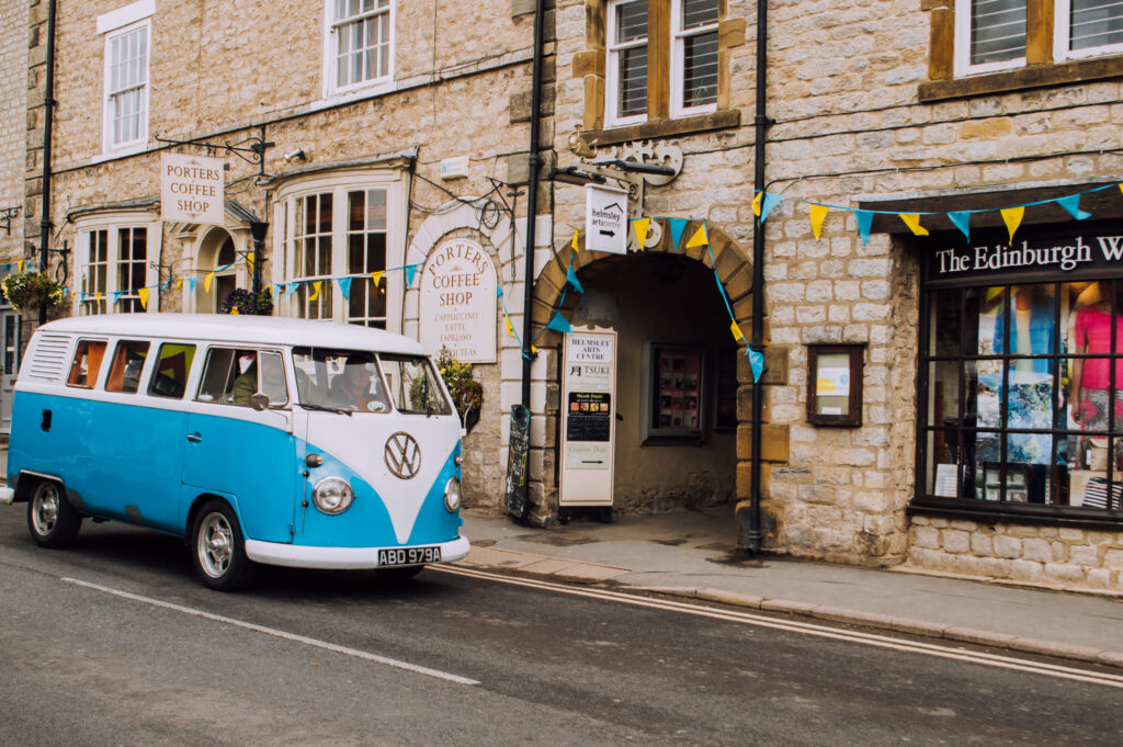 Old VW driving along the street in Helmsley market town