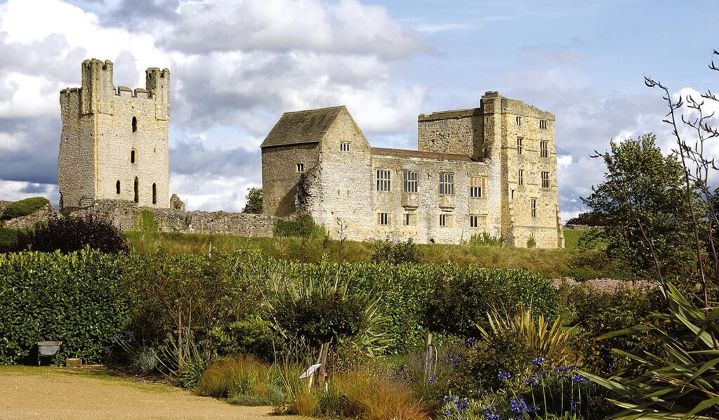 Helmsley Castle with flower bed in foreground