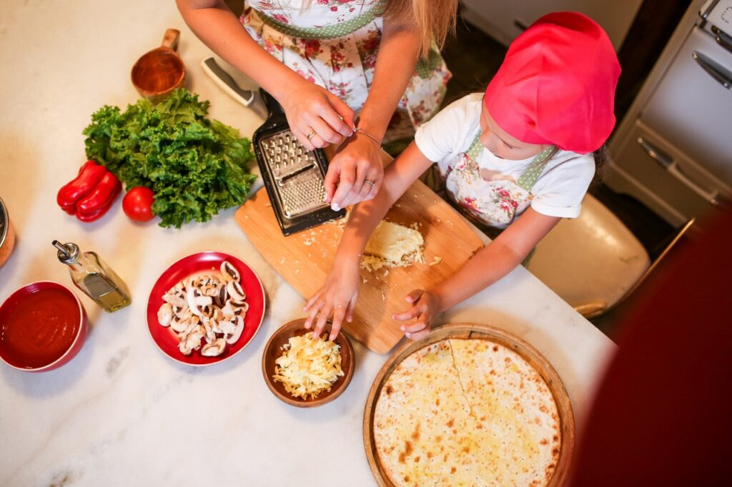 ariel shot of girl and lady cooking in kitchen
