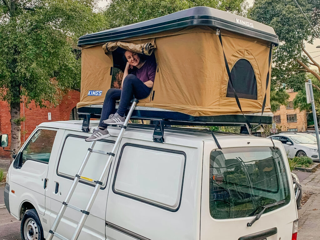 pop up roof top tent on top of small white van