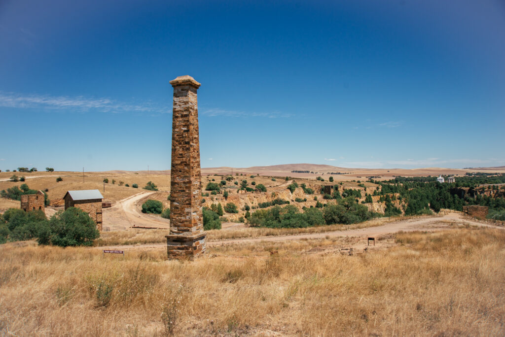 Stone Chimney in Burra with golden hills in the background