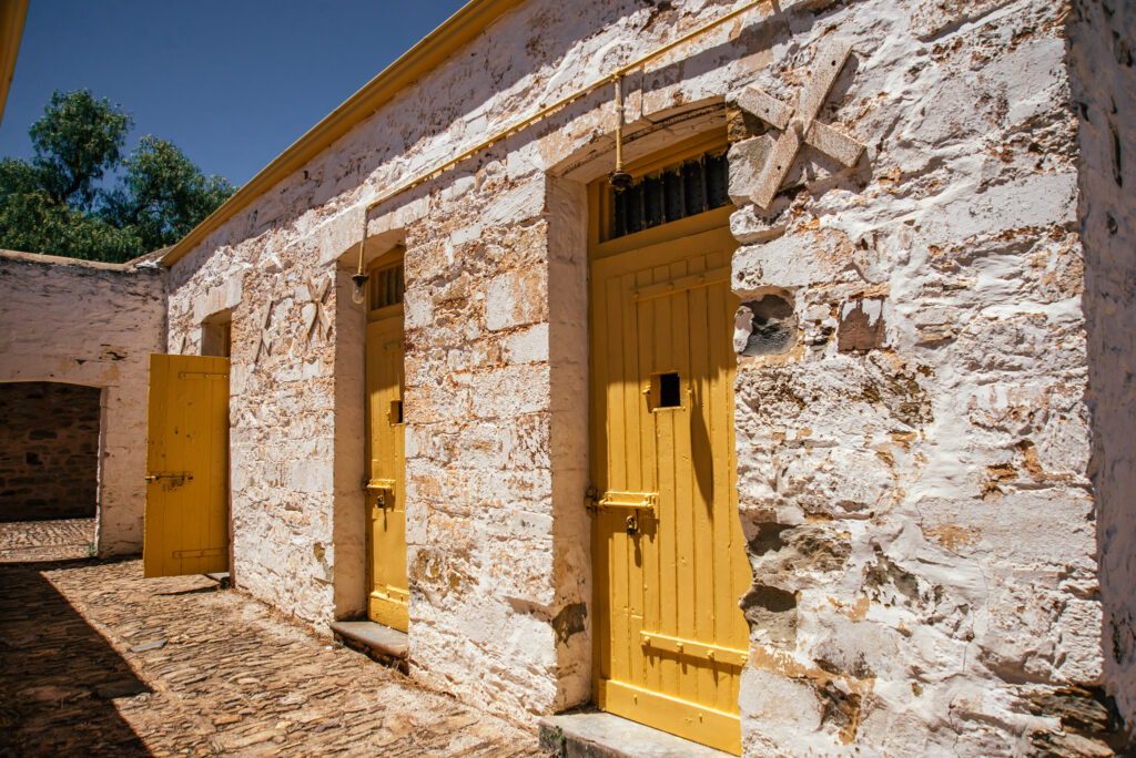 police lock up cells with yellow doors