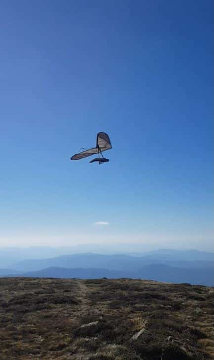 a paraglider at the top of mount bogong