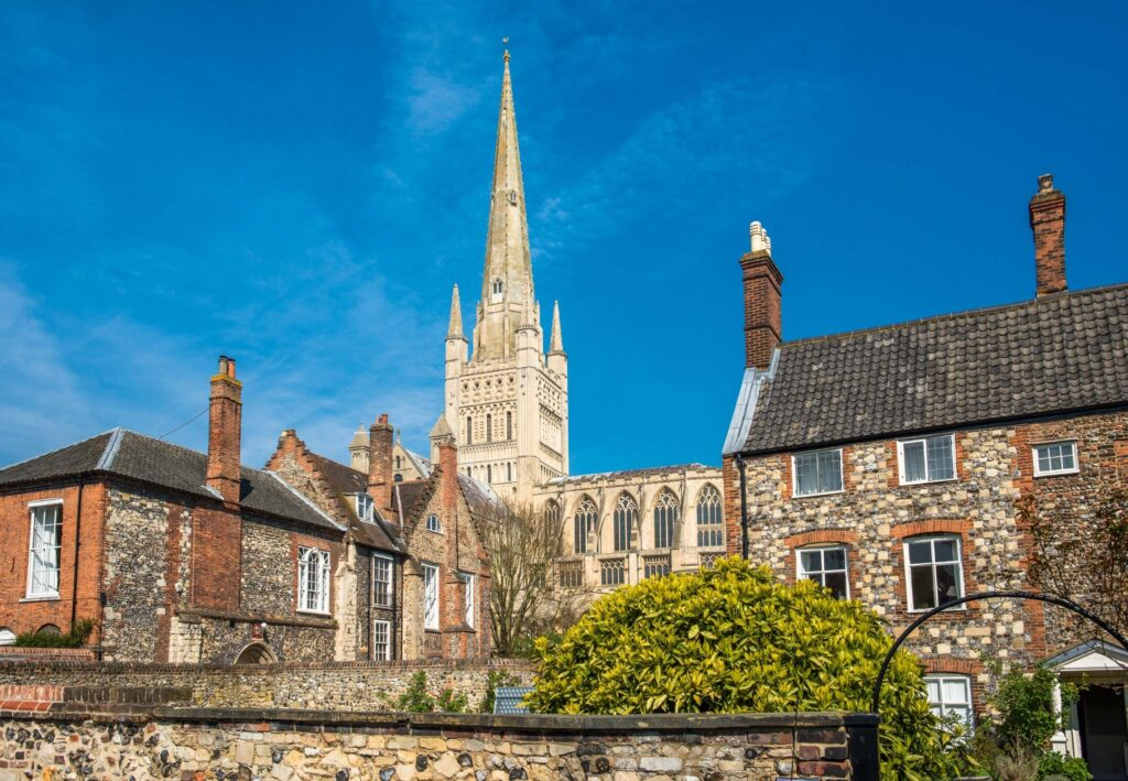 spire of Norwich cathedral behind houses