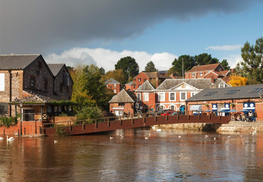 Exeter quayside and houses on a cloudy day in Devon England